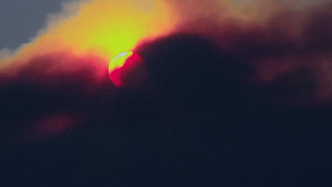 Smoke passes over the sun Footage