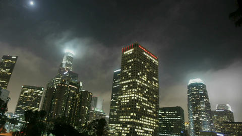 Lights illuminate high rise buildings in a downtown area... Stock Video Footage