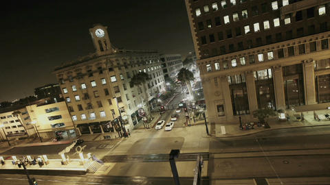 Traffic drives through a busy intersection at night Footage