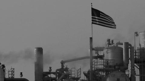 Smoke moves across the sky in an industrial area Stock Video Footage