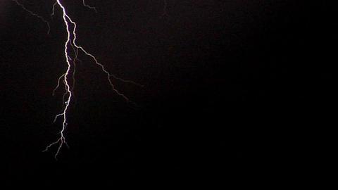 Lightening strikes illuminate a hillside Stock Video Footage