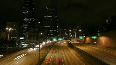 A Beautiful Shot Of Time Lapsed Freeway Traffic In A Downtown Area stock footage