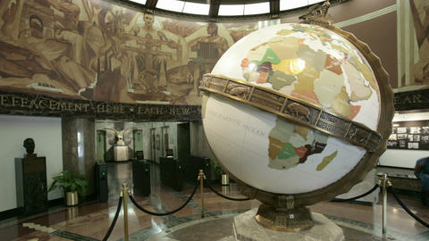A large globe turns in a museum or planetarium Live Action