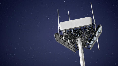 A magnificent shot of a transmitter against the moving night sky Footage