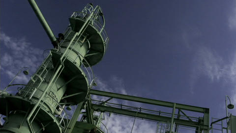 Clouds drift behind an oil refinery Stock Video Footage