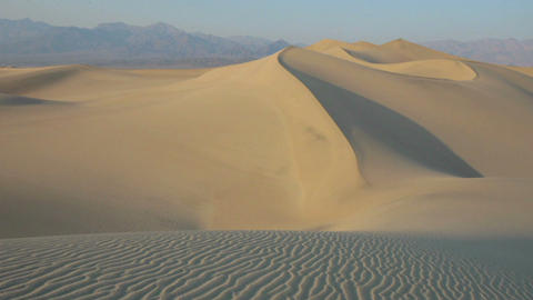Shadows move over a sand dune Stock Video Footage