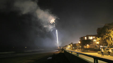 Fireworks explode off a beach Stock Video Footage