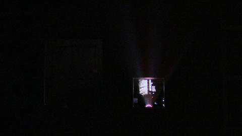 Light Shines From A Projector Into A Darkened Theater stock footage