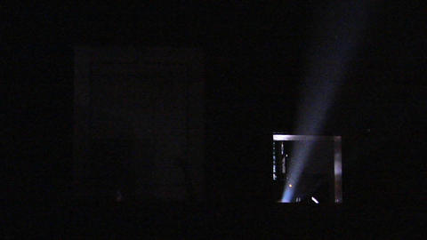 Light shoots out of a theater projector Stock Video Footage