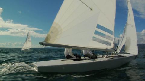 Sailboats race across the ocean Footage
