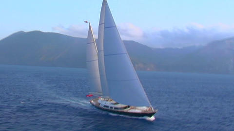 A magnificent aerial shot over a large sailboat at sea Stock Video Footage