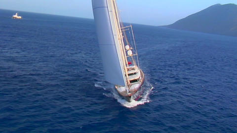 A magnificent aerial shot over a large sailboat at sea Footage
