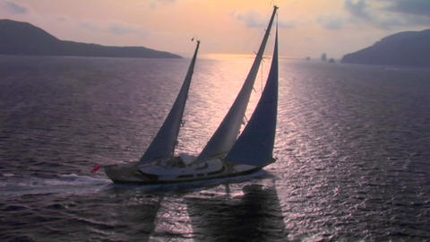 An aerial over a magnificent sailing boat on the open sea Stock Video Footage