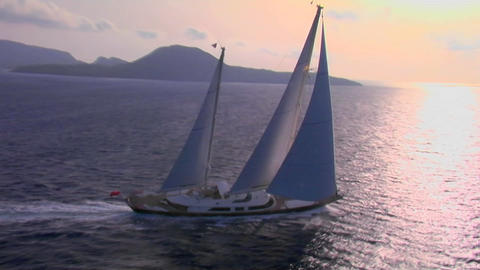 An aerial over a magnificent sailing boat on the open sea Footage