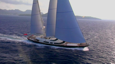 An aerial over a beautiful sailboat at sea Stock Video Footage