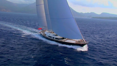 An aerial over a beautiful sailboat at sea Footage