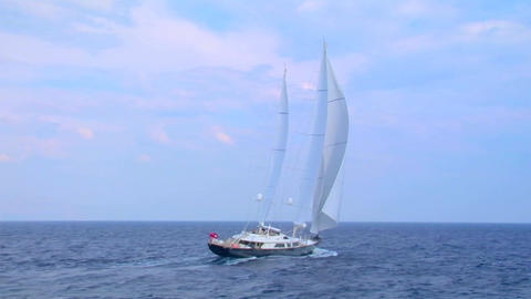 A sailboat sails on the open ocean Stock Video Footage