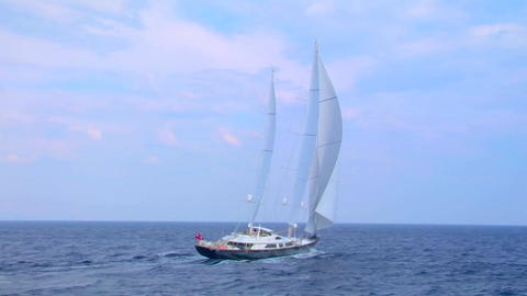 A sailboat sails on the open ocean Footage