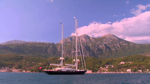 A boat is at anchor beside a beautiful island Stock Video Footage