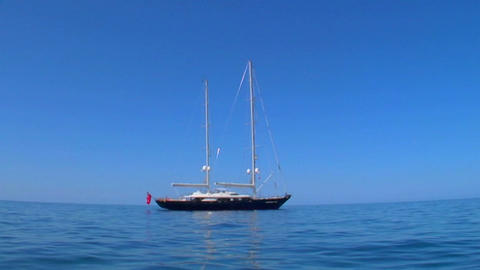 A sailboat cruises the high seas Footage