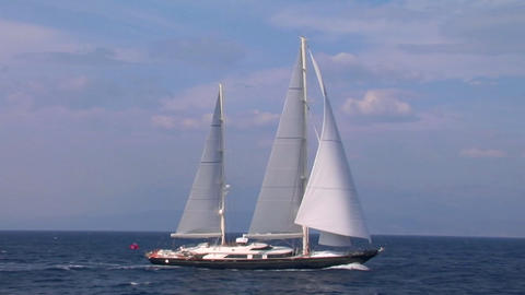 A sailboat cruises the high seas Stock Video Footage