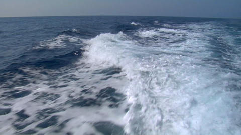 The wake of a boat as seen from the stern of a ship Stock Video Footage
