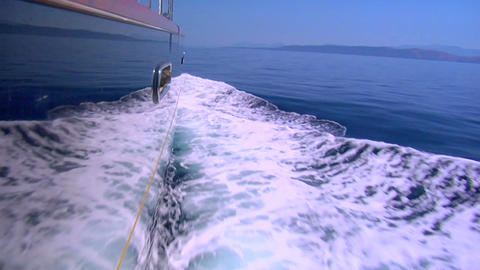 The wake of a boat as seen from the side of a ship Footage