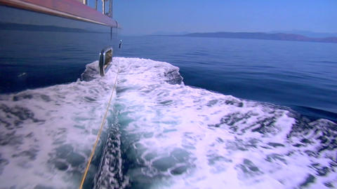 The wake of a boat as seen from the side of a ship Stock Video Footage