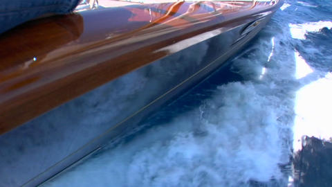 A view looking down at the wake of a wooden sailboat... Stock Video Footage