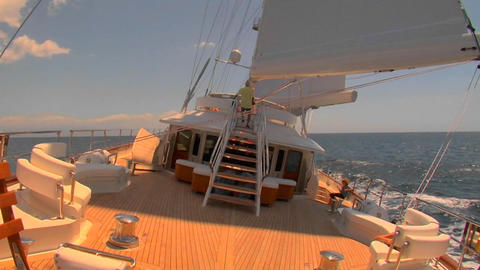 A sailboat travels across the ocean in this view from the... Stock Video Footage