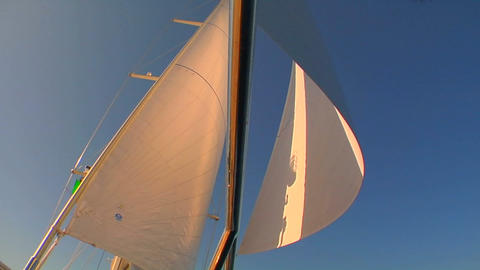 A pan across a sailboat in the Mediterranean as we tilt... Stock Video Footage