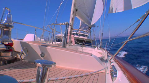 A sailboat's deck as it moves across the ocean and tilt... Stock Video Footage