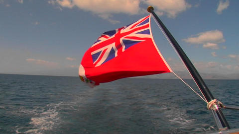 The flag of the Cayman Islands flies behind a ship on the... Stock Video Footage