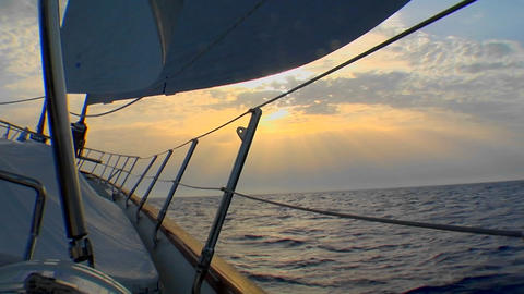 A shot of the side of a sailboat heading into the sunset Stock Video Footage
