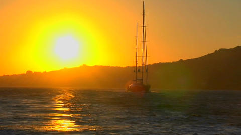 A sailboat against the setting sun Footage