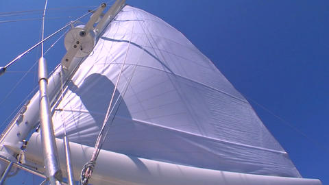 A sail blows in the wind on a sailboat Footage