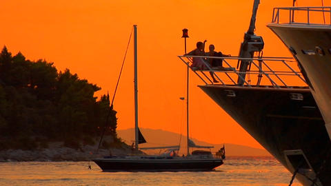 Children sit on the bow of a ship during Croatian sunset Stock Video Footage