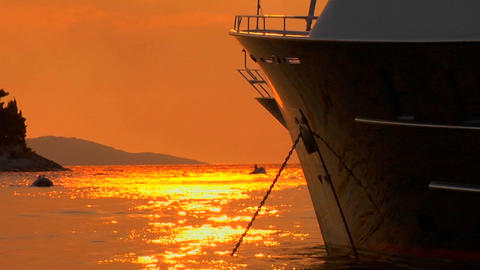 Croatian sunset on the water, ship bow in foreground Footage