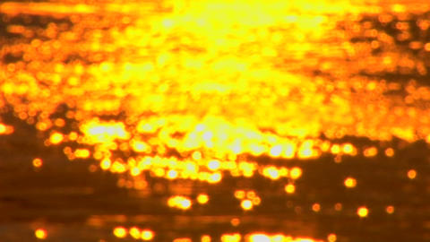 A Croatian sunset is reflected on the ocean Footage