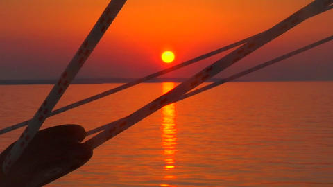 A Croatian sunset is visible through the ship's lines as its smoothly sails along the sea Footage
