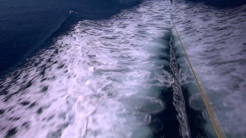 The wake of a sailboat passes by as it sails through the... Stock Video Footage