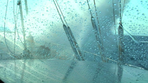 The view of the bow as a wave crashes over the deck Stock Video Footage