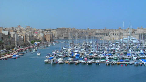 View of Malta's old city scape and ships in the harbor Footage