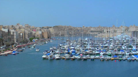 View of Malta's old city scape and ships in the harbor Stock Video Footage