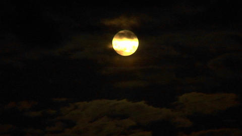 Full moon with clouds passing through Stock Video Footage