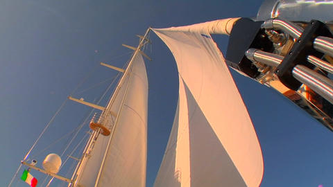View of sails on sailboat from deck as the wind fills... Stock Video Footage