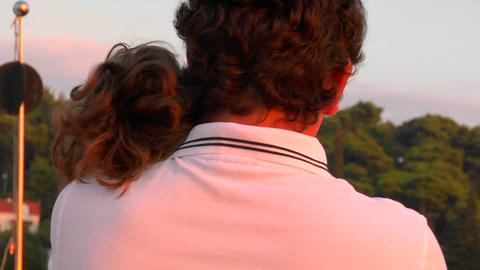 A father holds his daughter in the sunset Stock Video Footage