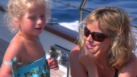 A girl hugs her mother on a sailing trip Stock Video Footage