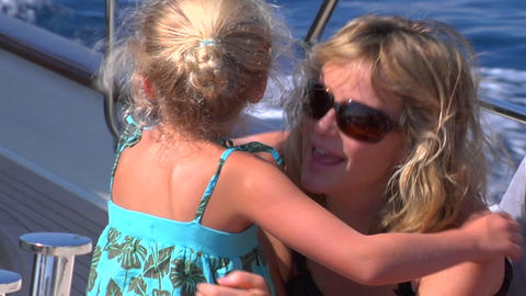 A girl hugs her mother on a sailing trip Footage