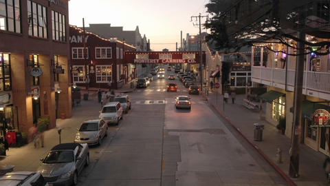 Time lapse at dusk of tourists on historic Cannery Row in Monterey, California Footage